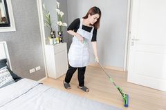 Young maid cleaning floor with mop at home, Cleaning service concept Royalty Free Stock Photos