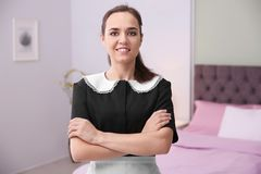 Young maid in room. Young maid in hotel room Royalty Free Stock Photo