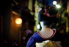 Young maiko walks in the streets of Gion corner. The Gion corner in Kyoto, the old imperial capital of Japan, is known but their geisha and maiko as the young Stock Photos