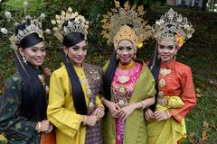 Traditional Malay entire. Young malay woman`s with Traditional Malay entire stock images