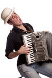 Young male with accordion Stock Images