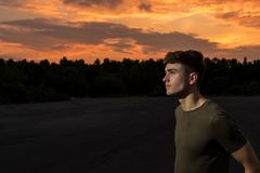 Young adult male outside at sunset. Young male adult outside at sunset Royalty Free Stock Photos