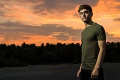 Young adult male outside at sunset. Young male adult outside at sunset Stock Photography