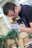 Young male apprentice doing carpentry work Royalty Free Stock Photography