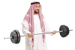 Young male Arab exercising with a barbell Stock Image