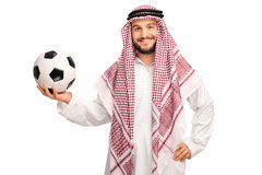 Young male Arab holding a football Royalty Free Stock Images