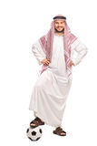 Young male Arab stepping over a football Royalty Free Stock Photos