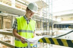 Young male architect at a construction site. Building, development, teamwork and people concept.  royalty free stock photos