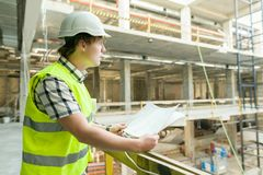 Young male architect at a construction site. Building, development, teamwork and people concept.  stock photos
