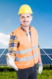 Young male architect doing handshake gesture. While standing in front of solar photovoltaic power station Stock Images