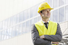 Young male architect standing arms crossed outside office building Royalty Free Stock Photos