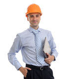 Young male architect wearing helmet. And holding laptop, isolated on white background Stock Photo