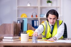 Young male architect working in the office royalty free stock image