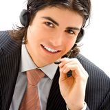 Young male assistant. With headset Stock Images
