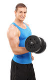 Young male athlete exercising with a small barbell Stock Images