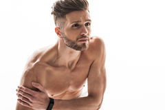 Young male athlete feels pain in shoulder Royalty Free Stock Images