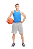 Young male athlete holding a basketball Royalty Free Stock Photos