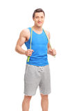 Young male athlete posing with a skipping rope Royalty Free Stock Photography