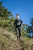 Young male athlete runs from mountain Royalty Free Stock Images