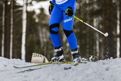 Young male athlete skier coming down mountain on skis Stock Image