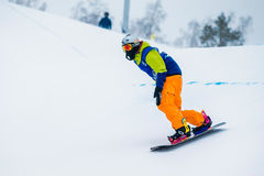 Young male athlete snowboarder downhill Stock Photos