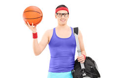 Young male athlete with sports bag holding a basketball Royalty Free Stock Photos