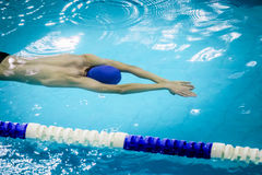 Young male athlete swimming under water. Chelyabinsk, Russia - October 21, 2015: young male athlete swimming under water during Championship of Chelyabinsk Stock Image