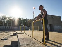 Young male athlete using hurdle to work out. Montreal, Quebec, Canada Stock Image