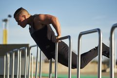 Young male athlete using hurdle to work out. Montreal, Quebec, Canada Stock Photography
