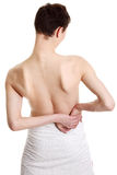 Young male with back pain Royalty Free Stock Image