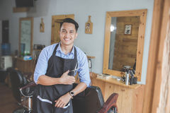 Young male barbershop owner smiling Royalty Free Stock Photo