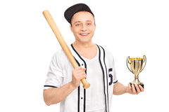 Young male baseball player holding a trophy Stock Photo