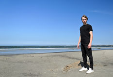 Young male on the beach Stock Images