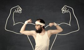 Young weak man with drawn muscles Royalty Free Stock Image