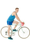 A young male bicyclist riding a bicycle Royalty Free Stock Photo