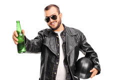 Young male biker holding a bottle of beer Stock Photo