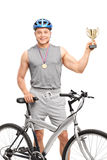 Young male biker holding a trophy Stock Photography