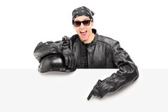Young male biker pointing on a billboard Stock Image