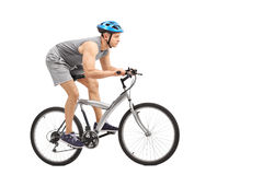 Young male biker riding a gray bicycle Stock Images