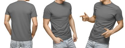 Young male in blank gray t-shirt, front and back view, isolated white background . Design men tshirt template and mockup for print royalty free stock photo