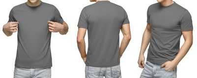 Young male in blank gray t-shirt, front and back view, isolated white background. Design men tshirt template and mockup for print royalty free stock image