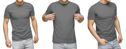 Young male in blank gray t-shirt, front and back view, isolated white background . Design men tshirt template and mockup for print. Young male in blank gray t royalty free stock images