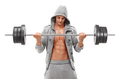 Young male bodybuilder exercising with a heavy barbell Stock Photo