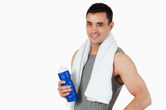 Young male with a bottle after workout Royalty Free Stock Photo