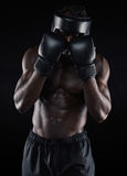 Young male boxer blocking Royalty Free Stock Image