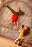 Brake dancer dancing on hands. Young male brake dancer dancing on his hands Stock Photos