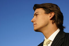 Young Male Businessman. Financial adviser looks to the future against a clear blue sky Stock Photography