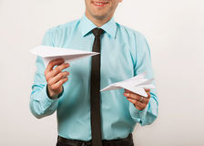 Young male businessman. Holding origami airplanes, studio stock photos