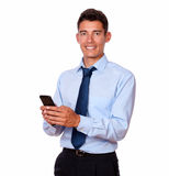 Young male businessman texting on his cellphone. While standing on isolated background Stock Photo
