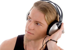 Young male busy with headphones Royalty Free Stock Photos